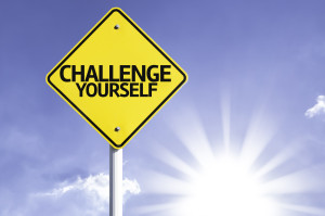 Challenge Yourself road sign with sun background