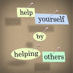 Help Yourself by Helping Others - Words Pinned on Board